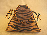 "Handmade Tiger Print Stingray Clutch Bag. 7.5""W X 6.5""H X 1.5""D.  Inside Alligator Pocket.  Black And Tan Doe Kid Leather Edge Braiding And Strap.  Magnetic Closure. (Back View)"