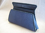 Handmade Sapphire Blue Stingray Clutch Bag. Bkack Kangaroo Lining With Inside Alligator Pocket.  Black Doe Kid Leather Hand Braiding.  Magnetic Closure.  PHD Logo ID Tag. (Front View)